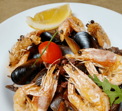 Tiger prawns with mussels and rice